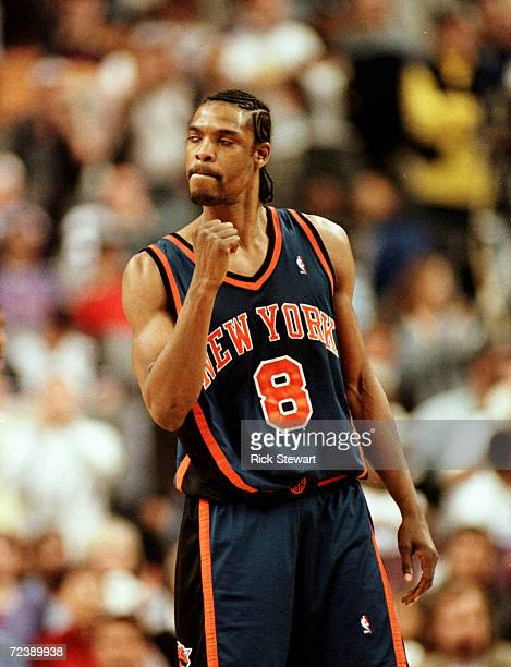 Guard Latrell Sprewell of the New York Knicks pumps his fist after the Knicks took the lead for good against the Toronto Raptors in Game 3 of the NBA...
