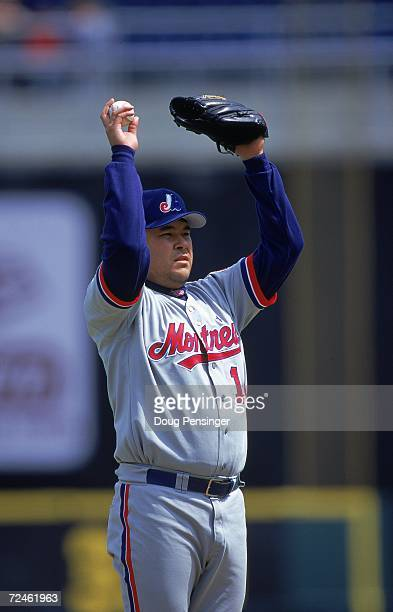 Hideki Irabu of the Montreal Expos reaches up to line the pitch during the game against the Philadelphia Phillies at the Veterans Stadium in...