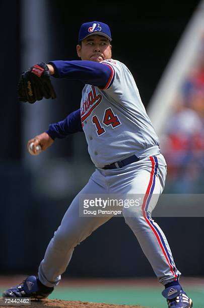 Hideki Irabu of the Montreal Expos winds back to pitch the ball during the game against the Philadelphia Phillies at the Veterans Stadium in...