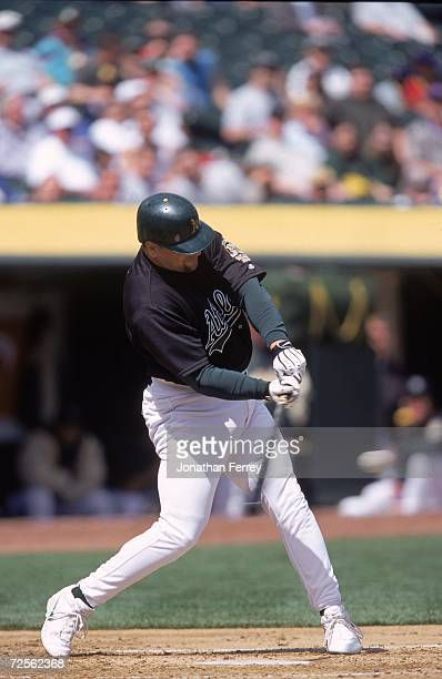 John Jaja of the Oakland Athletics swings to hit the ball during the game against the Detroit Tigers at the Network Associates Coliseum in Oakland...