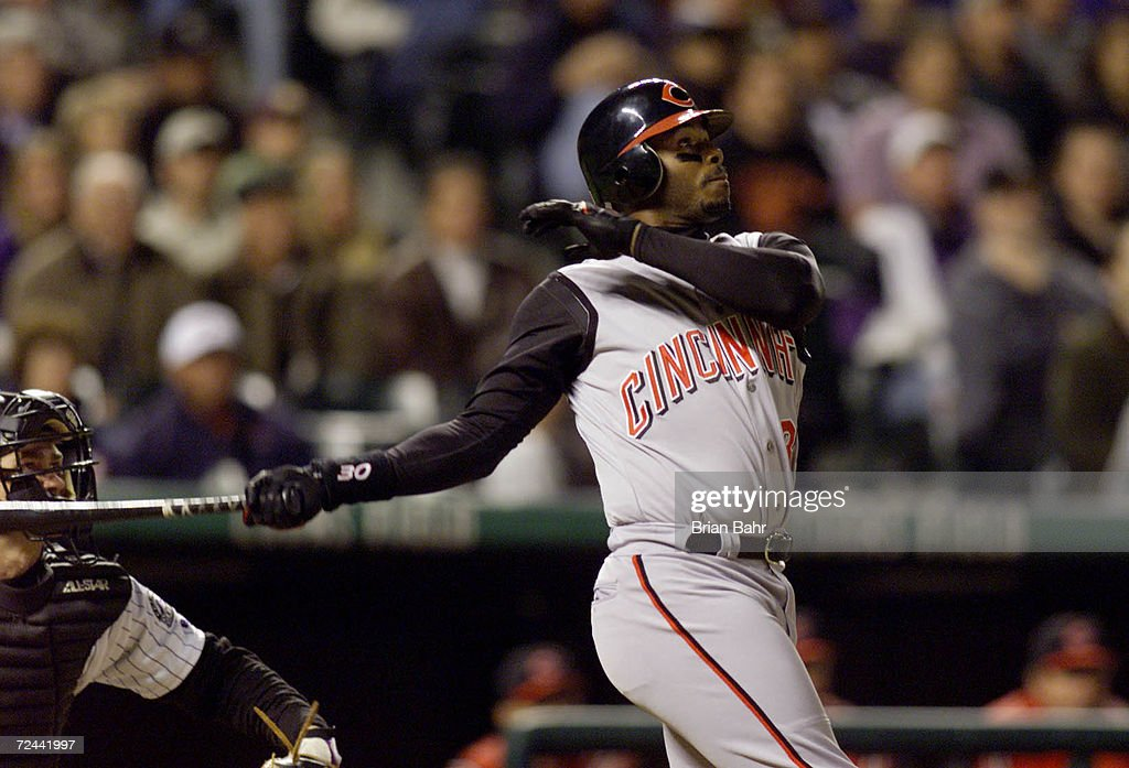 Ken Griffey, Jr. #30 of the Cincinnati Reds hits a grand slam for his 401st career home run in the fourth inning against Gabe White #36 of the Colorado Rockies at Coors Field in Denver, Colo. <DIGITAL IMAGE> Mandatory Credit: Brian Bahr/ALLSPORT
