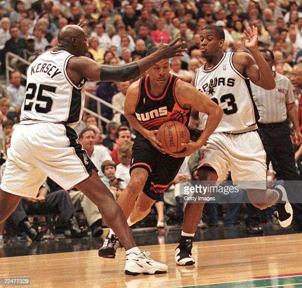 Kevin Johnson of the Phoenix Suns drives past Antonio Daniels and teammate Jerome Kersey in the NBA Playoff game at the Alamo Dome in San Antonio...