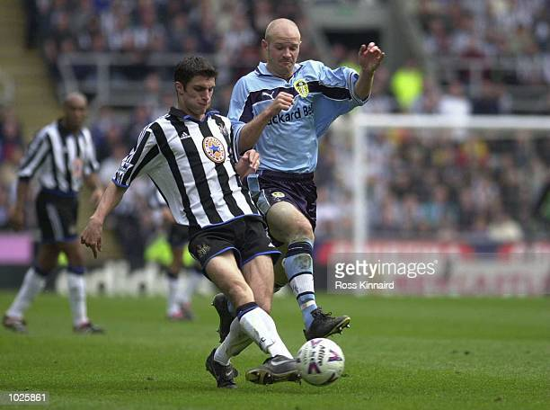 Lee Mills of Leeds battles with Aaron Hughes of Newcastle during the Newcastle United v Leeds United FA Carling Premiership match at St James's Park...