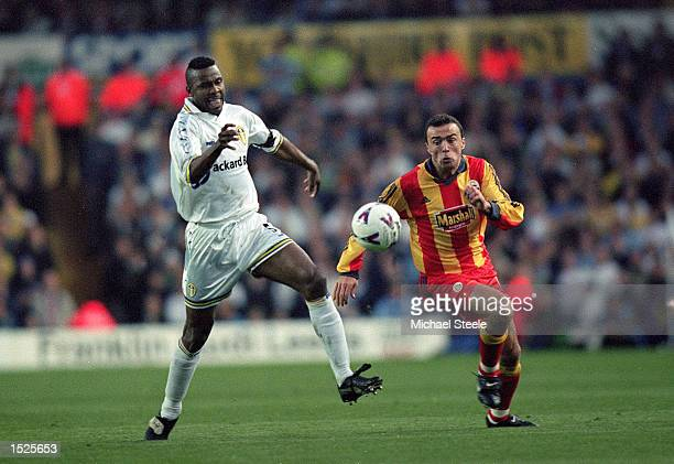 Lucas Radebe of Leeds United and Arif Erdem of Galatasaray chase the ball during the UEFA Cup Semi Final Second Leg game between Leeds United and...