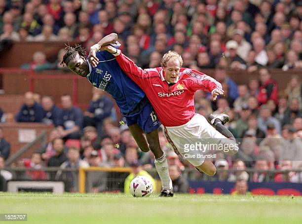 Mario Melchiot of Chelsea shrugs off Jordi Cruyff of Manchester United during the FA Carling Premiership match at Old Trafford in Manchester England...