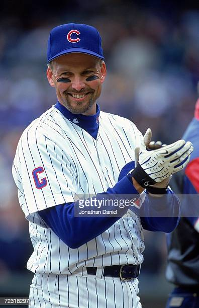 Mark Grace of the Chicago Cubs smiles as he claps on the field before the game against the Atlanta Braves at Wrigley Field in Chicago Illinois The...