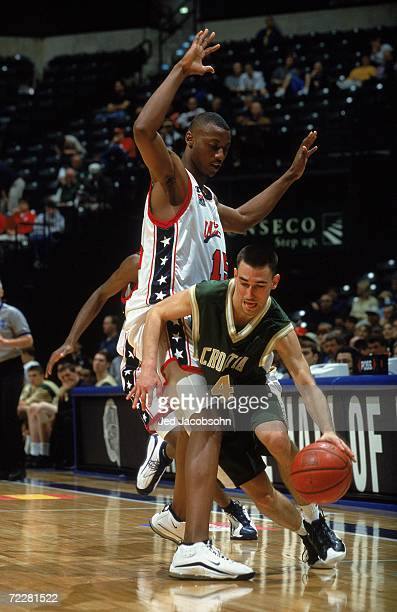 Marko Popovic of of Croatia who plays for Team World moves with the ball around Rolando Howell of Team USA during The Nike Hoop Summit at the Conseco...