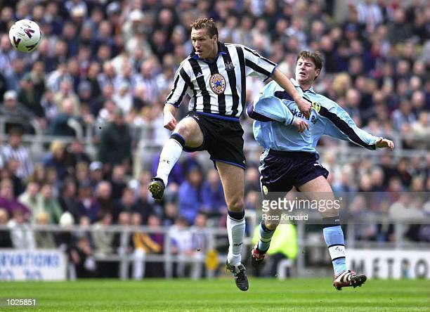 Michael Bridges of Leeds clashes with Steve Howey of Newcastle during the Newcastle United v Leeds United FA Carling Premiership match at St James's...