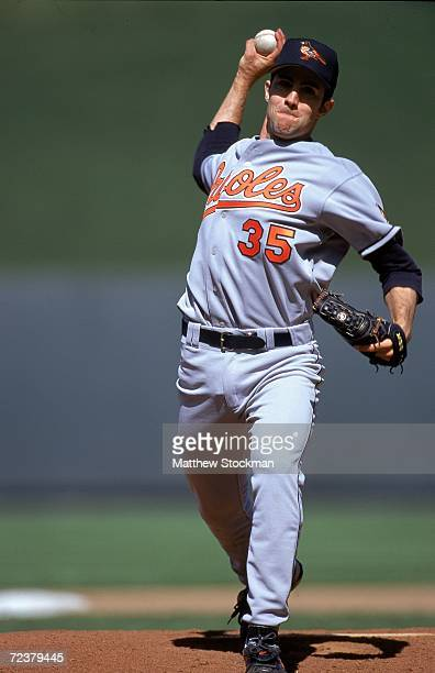 Mike Mussina of the Baltimore Orioles winds back to pitch the ball during the game against the Kansas City Royals at the Kauffman Stadium in Kansas...