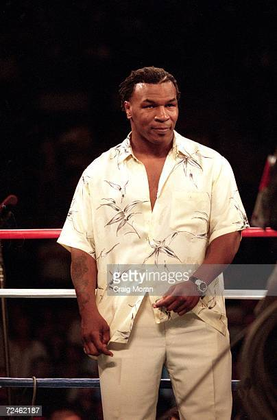 Mike Tyson watches the action during the IBF Junior Middleweight Championship between Fernando Vargas and Ike Quartey at the Mandalay Bay Resort in...