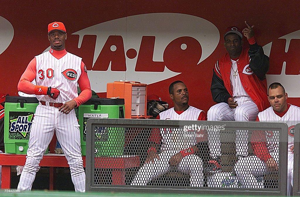 New Cincinnati Reds players Ken Griffey, Jr. #30, Deion Sanders #2 (atop the bench) and Dante Bichette #9 joke around between innings on opening day at Cinergy Field in Cincinnati, Ohio. X <DIGITAL