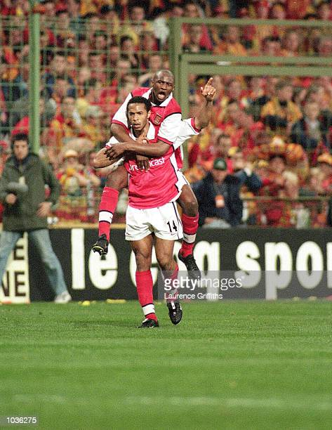 Patrick Vieira and Thierry Henry of Arsenal celebrate during the UEFA Cup Semi Final Second Leg game between Lens and Arsenal at the Felix Bollaert...