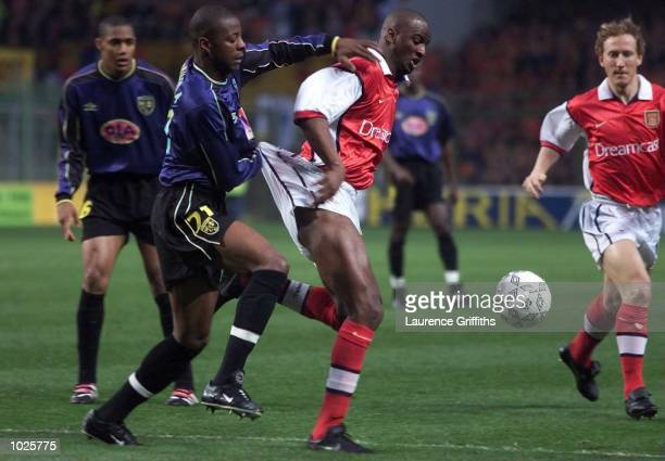 Patrick Vieira of Arsenal holds of the challenge of Pascal Nouma of Lens during the match between Racing Club Lens and Arsenal in the UEFA Cup...