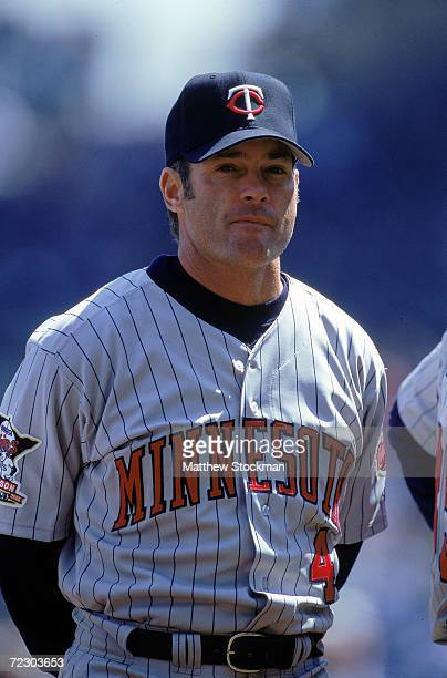 Paul Molitor of the Minnesota Twins stands on the field during the lineup before a game against the Kansas City Royals at Kauffman Stadium in Kansas...
