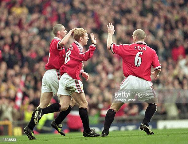 Paul Scholes of Manchester United celebrates his goal against West Ham United with team mates Roy Keane and Jaap Stam during the FA Carling...