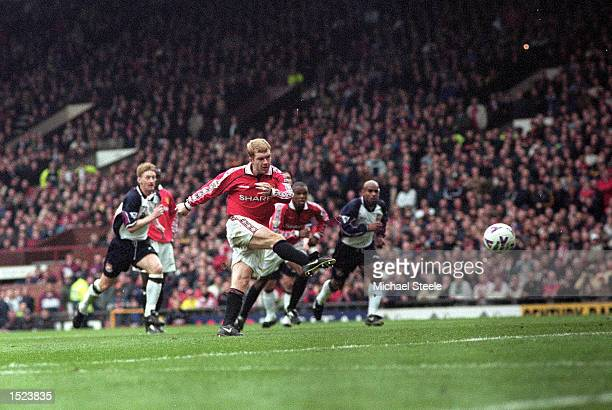 Paul Scholes of Manchester United scores from the penalty spot to complete his hattrick against West Ham United during the FA Carling Premiership...