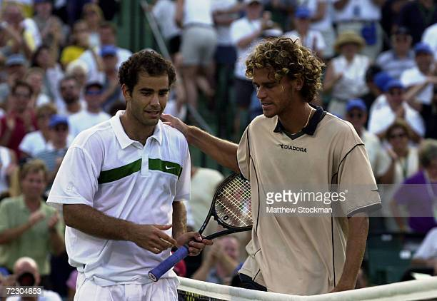 Pete Sampras is congratulated by Gustavo Kuerten of Brazil after the finals of the Ericsson Open at the The Tennis Center as Crandal Park on Key...