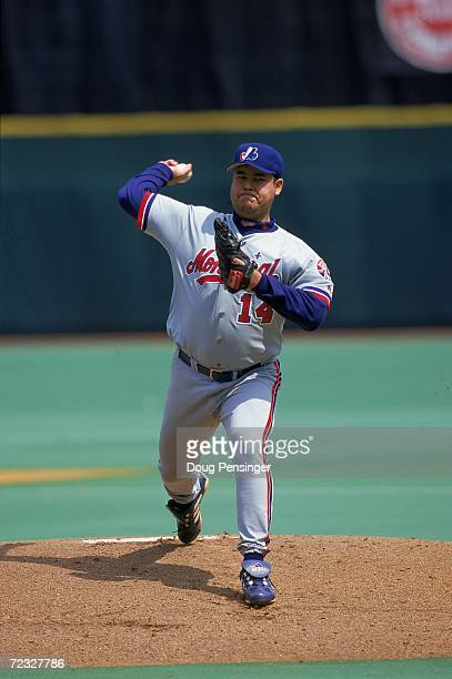 Pitcher Hideki Irabu of the Montreal Expos winds up for the pitch during the game against the Philadelphia Phillies at Veterans Stadium in...