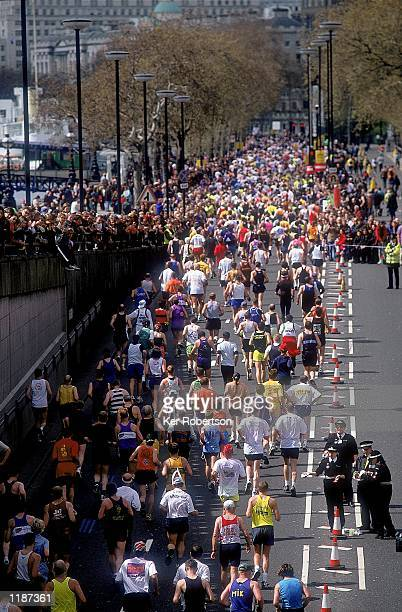 Runners emerge from the Blackfriars Underpass during Flora London Marathon in London England Mandatory Credit Ker Robertson /Allsport