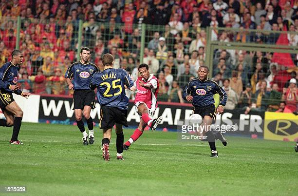 Thierry Henry of Arsenal scores their first goal on the night during the UEFA Cup Semi Final Second Leg game between Lens and Arsenal at the Felix...