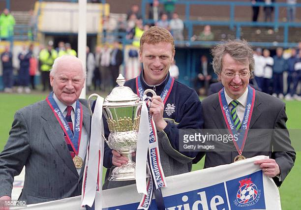 Tom Finney and Preston North End manager David Moyes lift the Division Two trophy after the Nationwide League Division Two match against Millwall at...