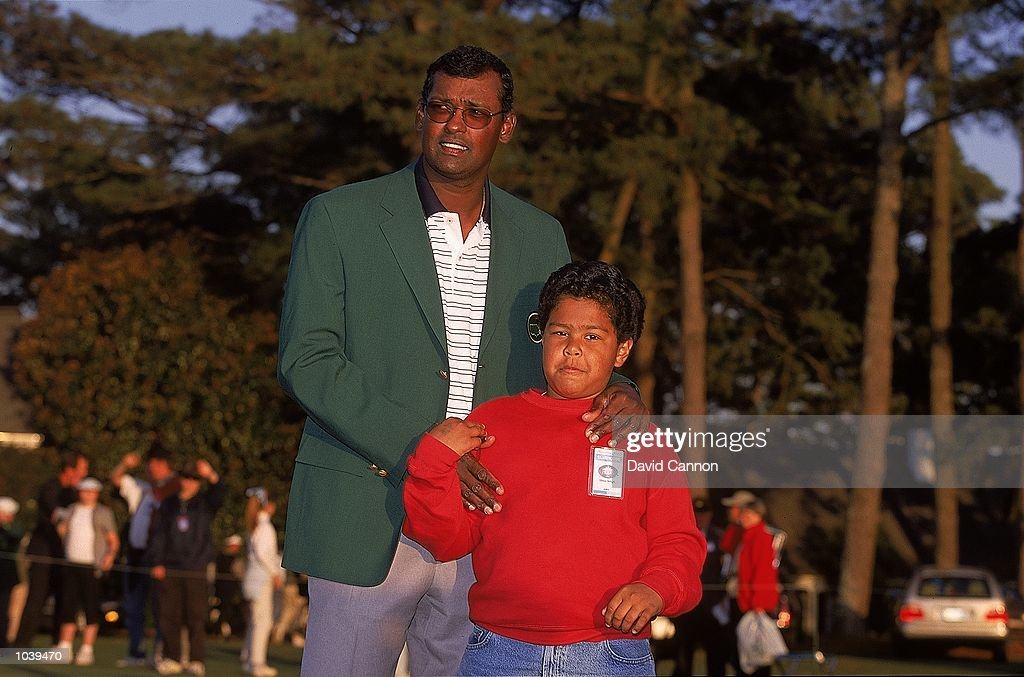 Vijay Singh of Fiji with his son after winning the US