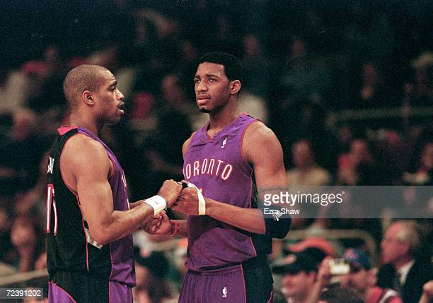 Vince Carter of the Toronto Raptors shakes hands with teammate Tracy McGrady during round one of the NBA Playoffs against the New York Knicks at the...