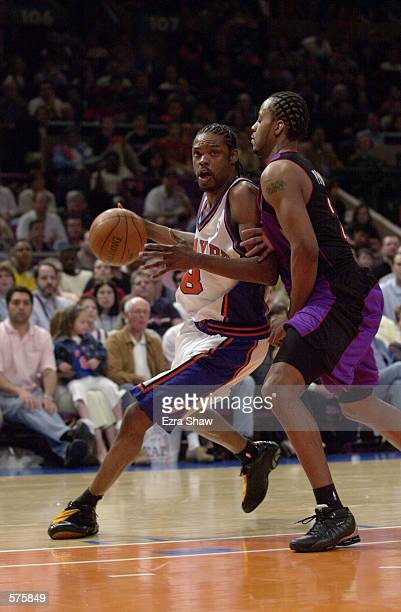 8Latrell Sprewell of the New York Knicks defended by Toronto Raptor during game 1 of round one in the NBA Playoffs at Madison Square Garden in New...