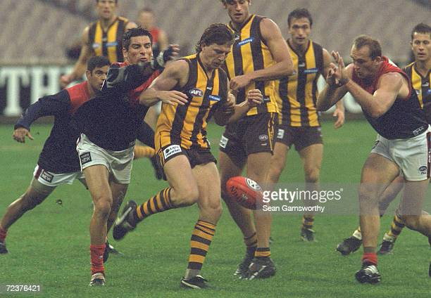 Adem Yze and David Neitz for Melbourne spoil Joel Smith for Hawthorn in the match between the Hawthorn Hawks and the Melbourne Demons played at the...