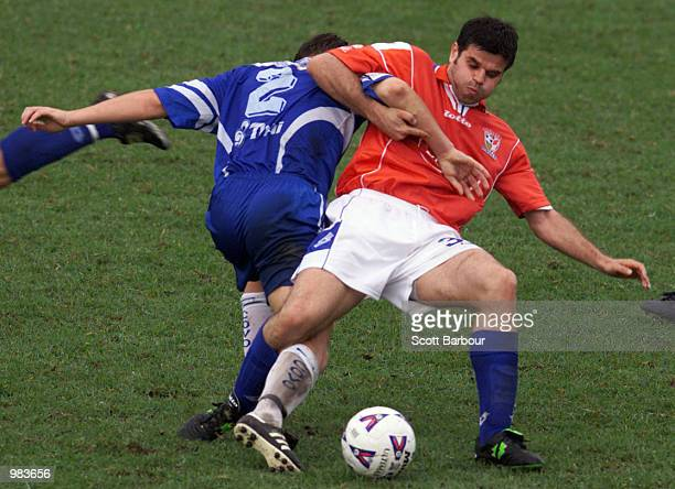 Aljosa Asanovic of Sydney United is tackled by Sebastian Sinozic of Sydney Olympic during the NSL match between Sydney United and Sydney Olympic...