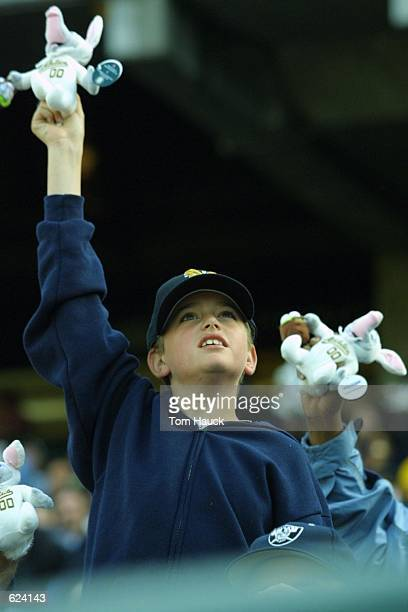 An Oakland A's fan waves his Easter A's Elephant that was passed out to fans attending the Easter Day game against the the Texas Rangers at the...