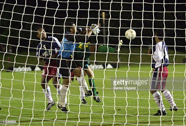 Archie Thompson of the Socceroos gets a goal past Nicky Salapu of American Samoa during the Oceania group one World Cup qualifier match between...