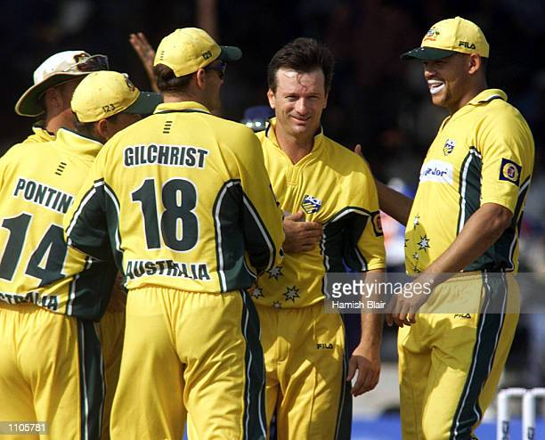 Australian captain Steve Waugh is congratulated by team mates after taking the wicket of Robin Singh of India, during the fourth One Day...