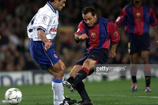 Barjuan Sergi of Barcelona shoots in front of Acuna of Zaragoza during the Barcelona v Real Zaragoza La Liga match played at the Nou Camp Barcelona...