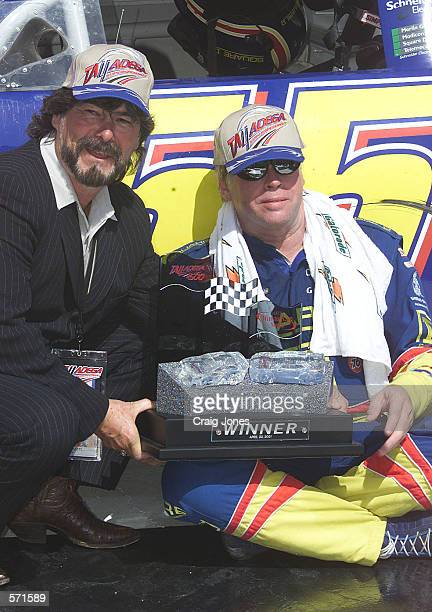 Bobby Hamilton driving the Square D Chevrolet receives the victors trophy from Country Music Legend Randy Owen after the NASCAR Winston Cup Talladega...