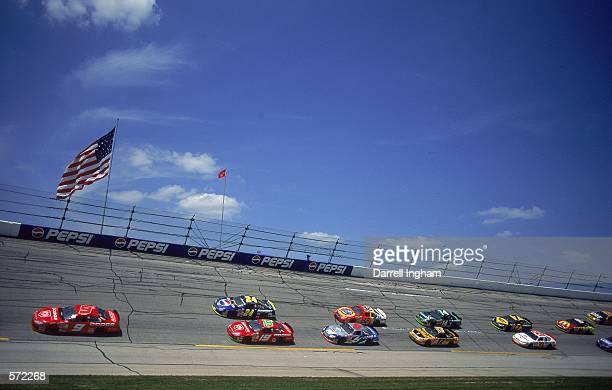 Casey Atwood who drives the Dodge Intrepid for Evernham Motorsports speeds around the track during the Talladega 500 presented by NAPA part of the...