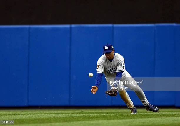 Center fielder Carlos Beltran of the Kansas City Royals fields the ball against the New York Yankees on Opening Day at Yankee Stadium in Bronx New...