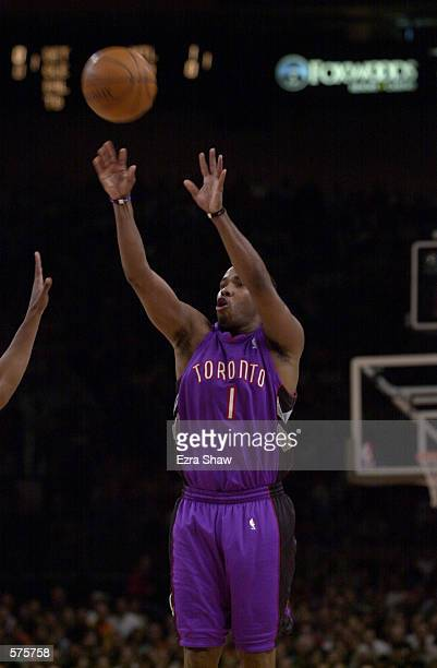 Chris Childs of the Toronto Raptors puts a shot up against the New York Knicks during game 1 of round one in the NBA Playoffs at Madison Square...