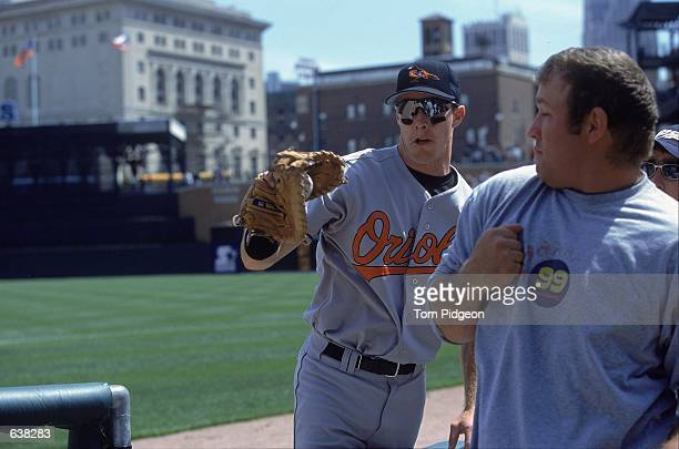 Chris Richard of the Baltimore Orioles makes the catch in the stands during the game against the Detroit Tigers at Comerica Park in Detroit,...