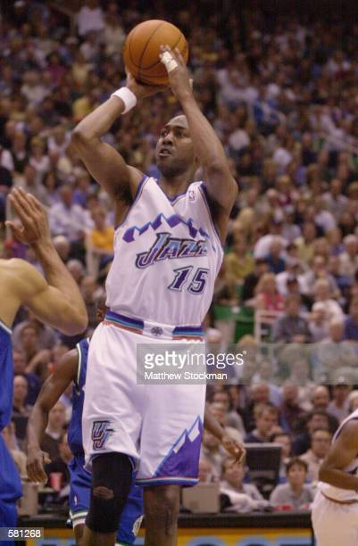 Danny Manning of the Utah Jazz puts a shot up over the Dallas Mavericks in game 2 of the NBA Playoffs at the Delta Center in Salt Lake City, Utah....