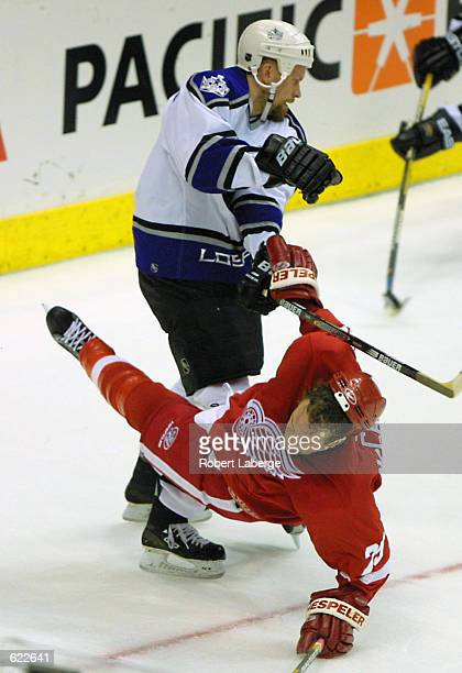 Darren McCarty of the Detroit Red Wings gets checked by Jere Karalahti of the Los Angeles Kings during the second period of Game 4 of the Western...