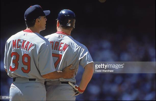 Dave McKay of the St Louis Cardinals pats teammate J D Drew during the game against the Arizona Diamondbacks at the Bank One Ballpark in Phoenix...
