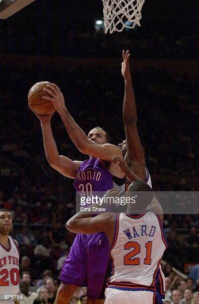 Dell Curry of the Toronto Raptors tries to put a shot up against the New York Knicks during game 1 of round one in the NBA Playoffs at Madison Square...