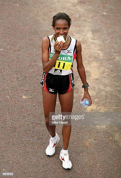 Derartu Tulu Celebrates With the Gold Medal after winning the Women's London Marathon during the Flora London Marathon in London England Mandatory...
