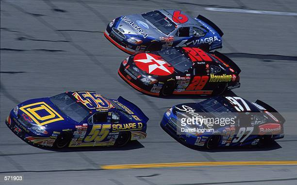 Driver Kurt Busch who drives the Roush Racing Rubbermaid/Sharpie Ford Taurus for Roush Racing races next to others during the Talladega 500 presented...