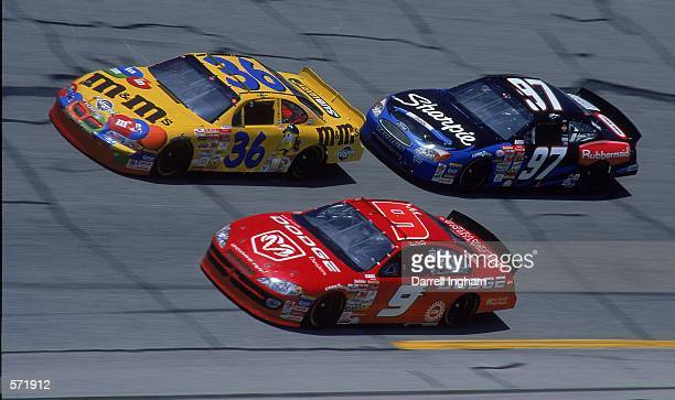 Driver Kurt Busch who drives the Roush Racing Rubbermaid/Sharpie Ford Taurus for Roush Racing is right behind car and ca r#9 during the Talladega 500...