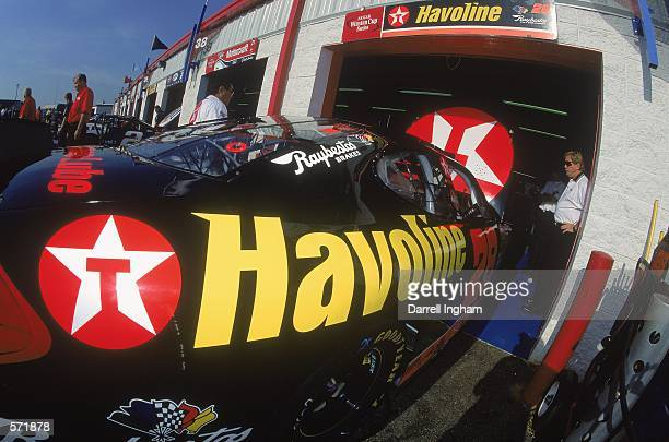 Driver Ricky Rudd in the Texaco Havoline Ford Taurus for Robert Yates Racing leaves the garage during the Talladega 500 presented by NAPA part of the...