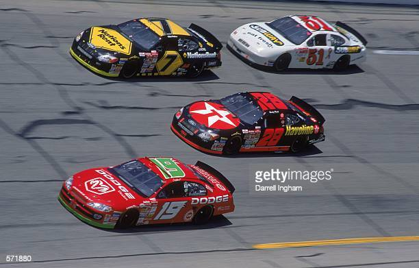 Driver Ricky Rudd in the Texaco Havoline Ford Taurus for Robert Yates Racing speeds down the track during the Talladega 500 presented by NAPA part of...