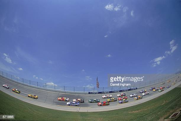 Driver Ricky Rudd in the Texaco Havoline Ford Taurus for Robert Yates Racing speeds around the track during the Talladega 500 presented by NAPA part...