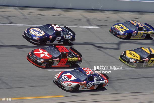 Driver Ricky Rudd in the Texaco Havoline Ford Taurus for Robert Yates Racing moves up the middle during the Talladega 500 presented by NAPA part of...